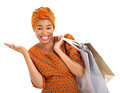 African woman shopping bags beautiful in traditional clothes carrying on white background Stock Images