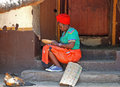 African woman south africa lesedi cultural village jan in traditional clothes sitting on the steps of house and work with beads on Stock Images