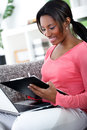 African woman studying at home young with laptop e learning Stock Photography