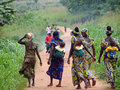 African women kuivonhoue benin august group of carrying their children in the back and walking on a laterite track Stock Photography