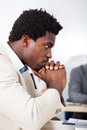 Afrikansk affärsman looking at laptop Arkivbild