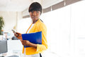 Afro american businesswoman holding folder and smartphone Royalty Free Stock Photo