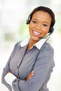 Afro american call center operator happy business with arms crossed Royalty Free Stock Photo