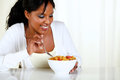 Afro-american female eating a bowl of cereals Royalty Free Stock Image