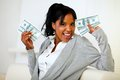 Afro-american girl holding plenty of cash money Royalty Free Stock Photo