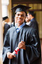 Afro american graduate good looking male on graduation day Royalty Free Stock Photography