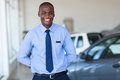 Afro american salesman good looking working at vehicle showroom Royalty Free Stock Photography