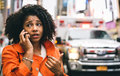 Afro american woman calling 911 in New york city. Royalty Free Stock Photo