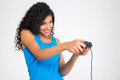 Afro american woman playing in video game with joystick