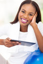 Afro american woman tablet pc happy with relaxing at home Stock Images