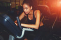 Afro american woman working out on spinning bike at gym Royalty Free Stock Photo