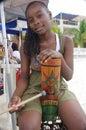 Afro caribbean girl smiling on the beach in roatan honduras Royalty Free Stock Photo