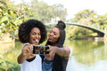 Afro friends having fun in the park taking selfie Royalty Free Stock Photo