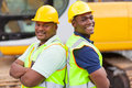 Afro mine workers cheerful american at mining site Stock Image