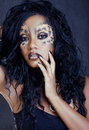 Afro woman with leopard make up cat at halloween Stock Photography