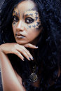 Afro woman with leopard make up cat at halloween Royalty Free Stock Images