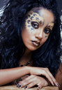 Afro woman with leopard make up cat at halloween Royalty Free Stock Image