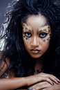 Afro woman with leopard make up cat at halloween Royalty Free Stock Photos