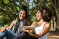 Afro women using tablet computer in the park Royalty Free Stock Photo