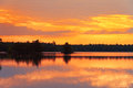 Afterglow sunset on a summer evening on a lake in southern sweden Royalty Free Stock Images