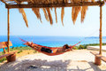 Afternoon relax young man relaxing in a hammock on the island of zakynthos greece Stock Photo