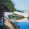 Afternoon still a white bridge is reflected on a canal in venice ca in an acrylic painting Stock Photos