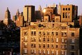 Afternoon sun giving manhattan buildings golden hue Royalty Free Stock Images