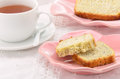 Afternoon tea lemon poppyseed loaf slices with cup of in horizontal format Stock Image