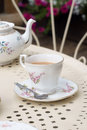 Afternoon tea served in vintage floral mismatched cups and saucers Royalty Free Stock Photos