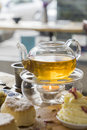 Afternoon tea with teapot and scones on table in a cafe