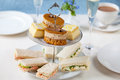 Afternoon tea traditional english with cakes and sandwiches Stock Photography
