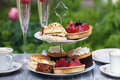 Afternoon tea traditional english with cakes and sandwiches Stock Photo