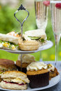 Afternoon tea traditional english with cakes and sandwiches Stock Images