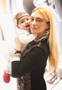 Aged blonde woman holding baby girl on hands closeup portrait of women Royalty Free Stock Photo