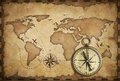Aged brass antique nautical compass and old map Royalty Free Stock Photo