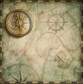 Aged brass antique nautical compass and old treasure map Royalty Free Stock Photo