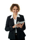 Aged businesswoman using touch screen device Stock Photo