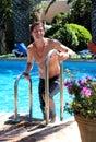 Aged climbing handsome man middle out pool swimming Στοκ φωτογραφίες με δικαίωμα ελεύθερης χρήσης