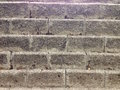 Aged concrete blocks wall, background texture Royalty Free Stock Photo