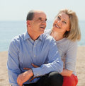Aged couple spending time together in bathing place Stock Photos