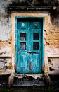 Aged door green in crack brick wall Royalty Free Stock Images