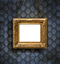 Aged, gold plated empty picture frame Royalty Free Stock Photo