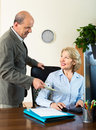Aged male accountant paying salary in cash office Stock Photos
