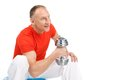 Aged man workout using dumbbell happy guy lifting weights on white background Royalty Free Stock Photography