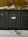 Aged metal mailboxes on old stone wall typical european Royalty Free Stock Photo