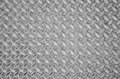 Aged metal seamless steel diamond plate texture pattern background Royalty Free Stock Photo
