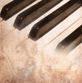 Aged paper with black and white piano keys Royalty Free Stock Photo