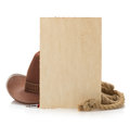 Aged paper and cowboy hat on white background Royalty Free Stock Photography