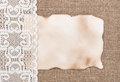 Aged paper with lacy cloth on sacking background texture of Royalty Free Stock Photography