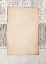 Aged paper and linen fabric on the old wood wooden background Stock Photography